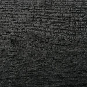 Close up of charred timber cladding - charred level: Deep Char