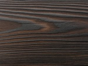 Close up of charred timber cladding - charred level: Dusk