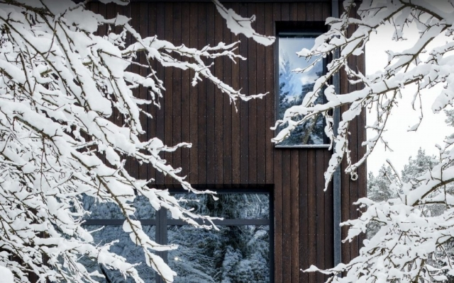 PermaChar - scorched larch cladding building in the snow