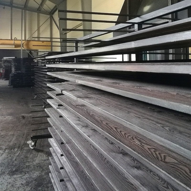 Charred Larch Cladding - Order carefully stacked in factory