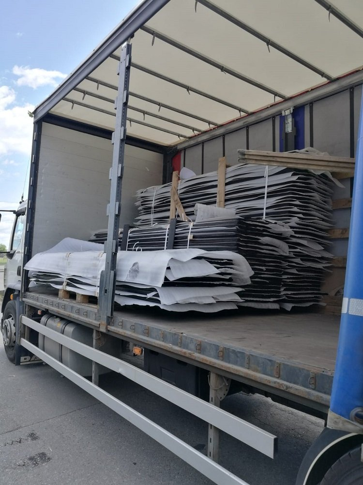 Charred timber cladding carefully stacked on lorry ready for delivery