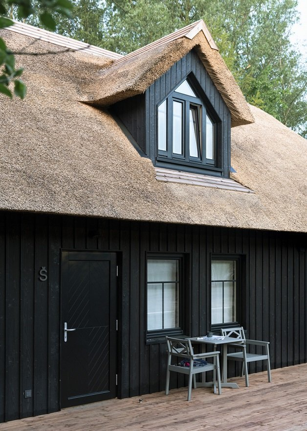 Thatched cottage with charred timber cladding